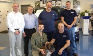 Manager Dean Pells, left, and the MobilityWorks team in Colonie with mascot Cooper